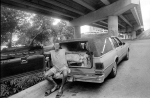 """Mike, in his hearse, """"Big Junko"""", which he has lived in for the last nine years.  Festival Beach on Lady Bird/Town Lake."""