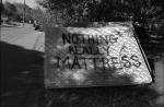 Graffiti on mattress. New York Avenue and Martin Luther King Boulevard.