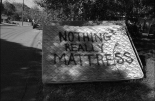 Graffiti on mattress. New York Avenue and Martin Luther King Boulevard.