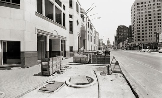 Northwest corner, Congress Avenue and Sixth Street, looking north. One American Center, nearing completion. (1984)