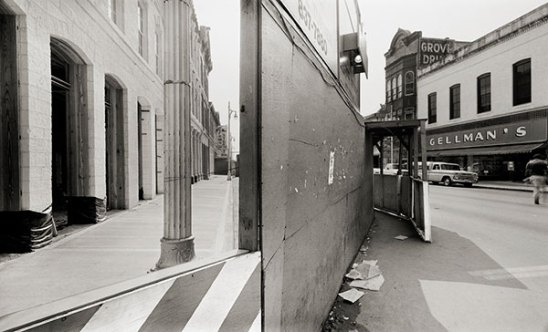 Northeast Corner, East Sixth and Brazos Streets, Looking East. (1983)